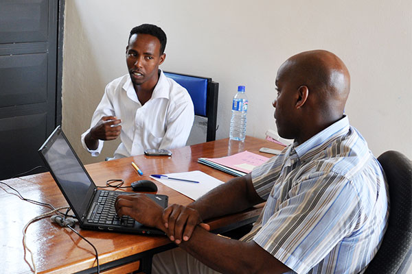 An ICMC resettlement expert conducts an interview with a refugee in Uganda