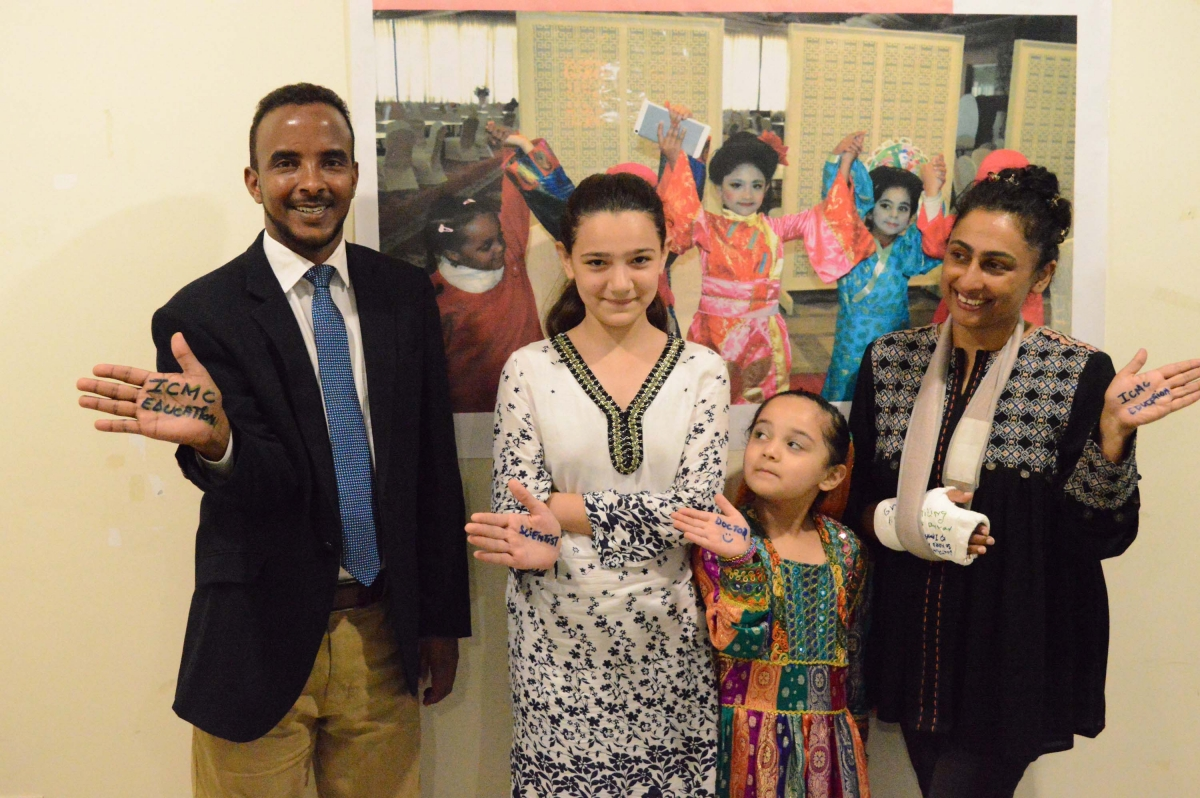 Two Afghan refugee girls meet with Samina and Hasan, a Somali interpreter, who is sponsoring their studies.